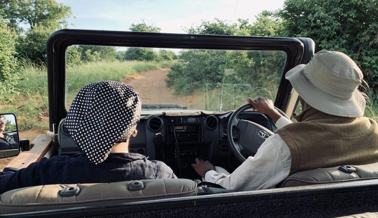 Katrina Holden in safari car with Cavin_Botswana