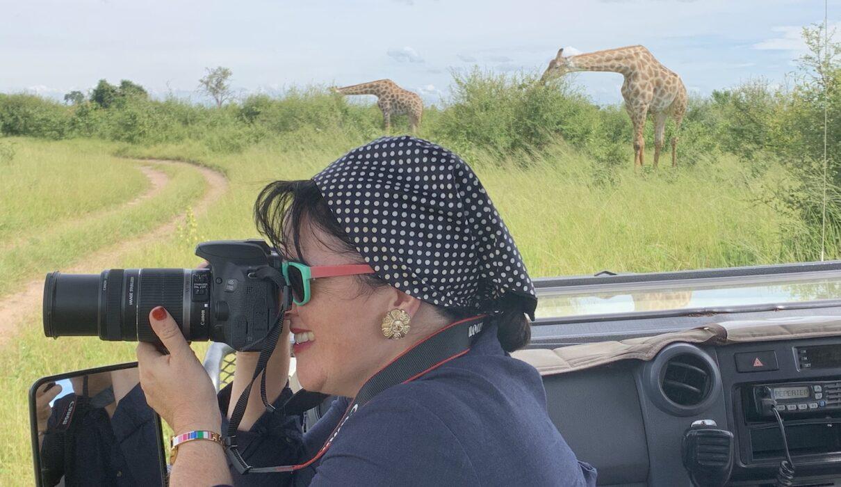 Katrina Holden photographing girafes on safari in Chobe National Park Botswana